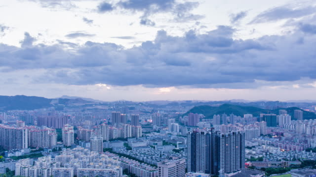 T/L WS view of Shenzhen skyline from day to night