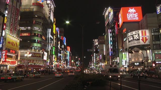 WS View of Shinjuku street scene at night / Tokyo, Kanto, Japan