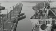 WS POV View of ship moving through Panama Canal as locks or canal gates open