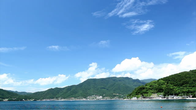 View of Shodo island and glistening blue sea on sunny day