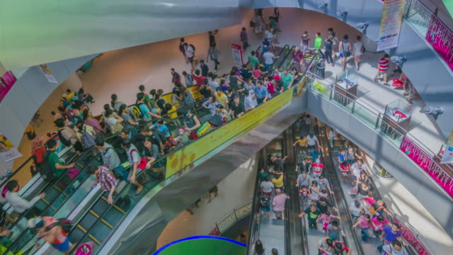 MS ZO T/L View of Shoppers moving on escalators in Vivo city / Singapore