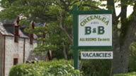 MS View of signs board near house / Drumnadrochit, Great Glen, Highlands, Scotland