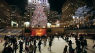 WS TU View of Skaters and illuminated Christmas Tree at Rockefeller Center at night / New York, United States