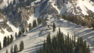 MS AERIAL DS View of ski lift hut on top of snowy slope / Park City, Utah, United States