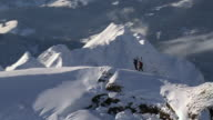 WS AERIAL View of Ski scatters on summit mountain top / Oberstdorf, Bavaria, Germany