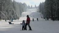 WS View of skier and snowboarder on piste, winter sport and snow ski lift / Erbeskopf, Hunsruck, Rhineland Palatinate, Germany