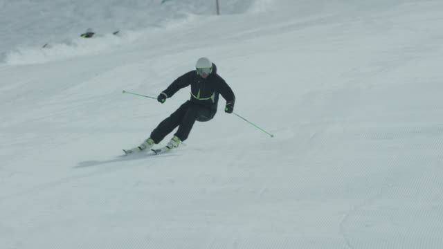View of skier skiing down slope.