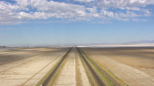 WS AERIAL TD View of sky and highway 80 southwest of Great Salt lake en route from Salt lake City to Bonneville Salt Flats / Utah, United States