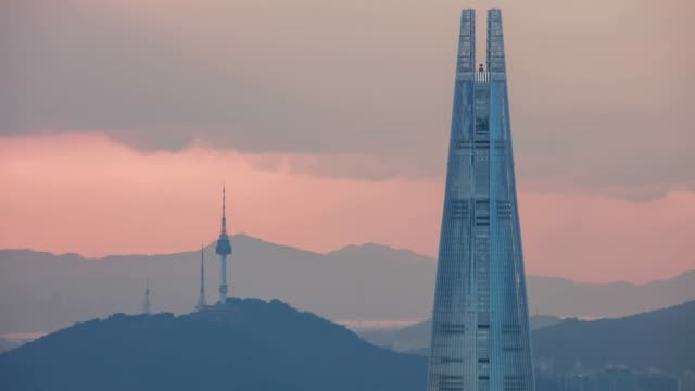View of skyline of Lotte World Tower (the tallest building in Korea) and distant N Seoul Tower (Famous tourist destination) at night