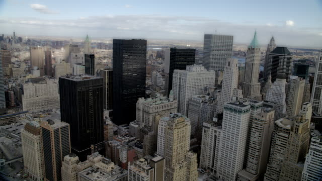 WS AERIAL View of skyline of Lower Manhattan financial district / New York, United States