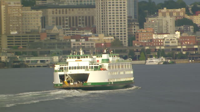 WS AERIAL ZO View of skyline with ferry boat moving in water / Seattle, Washington, United States