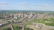 WS AERIAL POV View of skyscraper in city / Des Moines, Iowa, United States