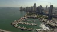 WS ZI ZO POV AERIAL View of skyscrapers, park, bridge and marina in downtown / Miami, Florida, USA