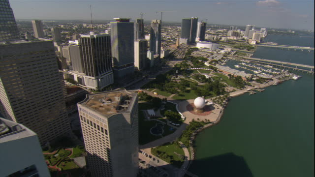 WS POV AERIAL View of skyscrapers, park, bridge and marina in downtown / Miami, Florida, USA