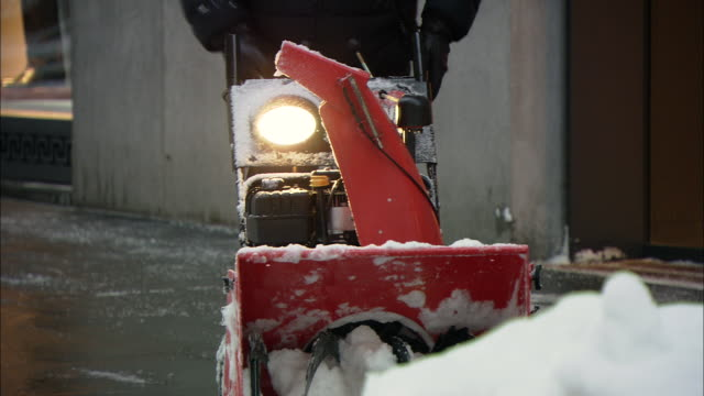 CU ZO TU PAN View of snow blower in Wall St. area / New York, New York, United States