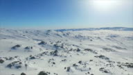WS AERIAL View of snow capped mountains in winter,Xinjiang,China.