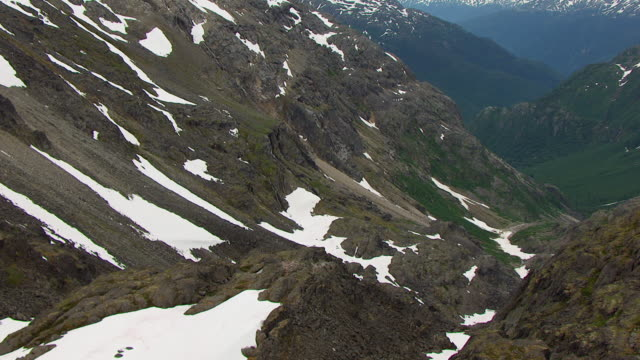 WS AERIAL TD View of snow covering mountains at Chilkoot Pass / Alaska, United States