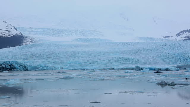 MS PAN View of snow mountain with Fjallsarlon Glacier Lake at rainy morning / Iceland