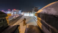 WS T/L PAN View of Snow scene and Nightscape of Janganmun(North gate) of Hwaseong Fortress( a World Heritage site by the UNESCO) / Suwon, Gyeonggido, South Korea