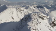 WS POV AERIAL View of snow-covered mountain peaks / Golden, British Columbia, USA