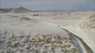 WS POV View of snowplow driving through mountain road / Mammoth Lakes, California, USA