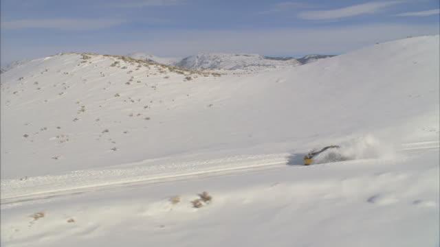 WS POV View of snowplow plowing through mountains / Mammoth Lakes, California, USA