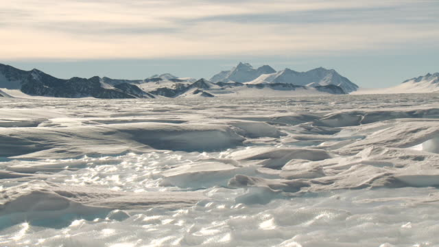WS View of Snowy and icy landscape with mountains and bright sunshine / Union Glacier, Heritage Range, Ellsworth Mountains, Antarctica