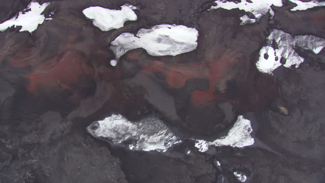 WS AERIAL View of snowy lava plain with mountain / Iceland