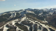 MS AERIAL View of snowy ski slopes / Park City, Utah, United States