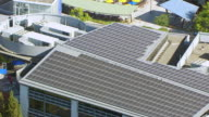 MS PAN AERIAL POV View of solar panels on roof of building, Googleplex, Google campus area / Mountain View, California, United States