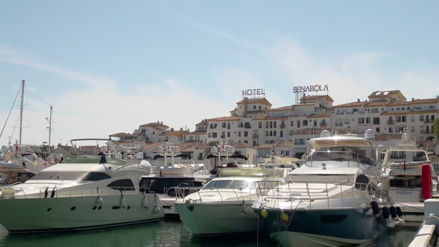 MS View of Some motor boats attached on jetty at Puerto Banus near Marbella / Puerto Banus, Andalusia, Spain