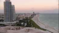 WS POV View of South beach with cityscape at twilight sky / Miami, Florida, USA