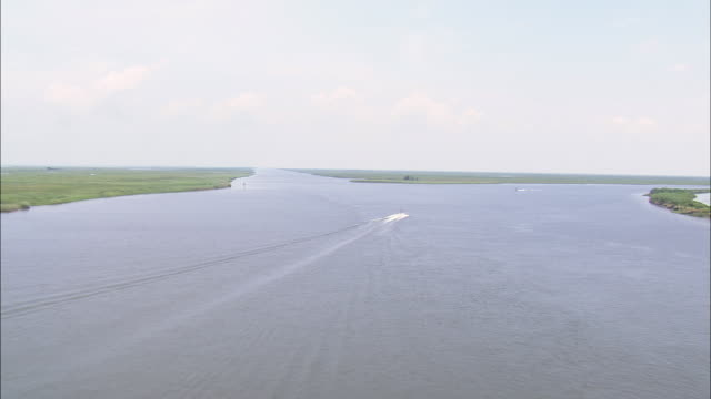 WS AERIAL View of Speed boats moving on canal / Louisiana, United States