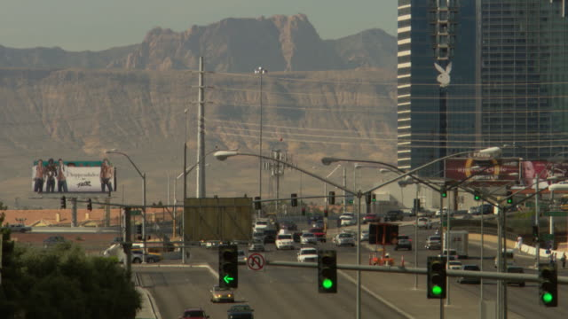 WS View of Spring Mountains with traffic signal / Las Vegas, Nevada, United States