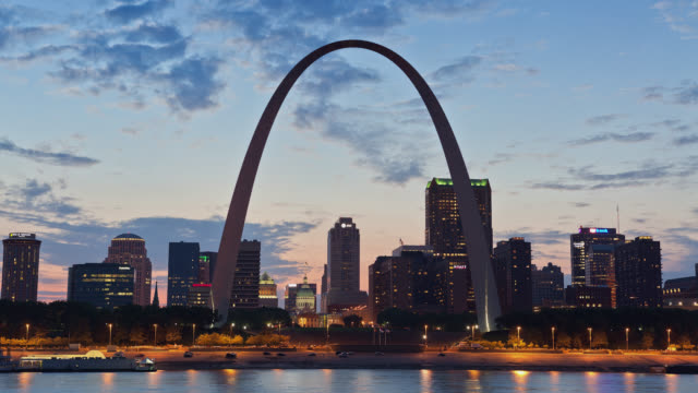 T/L View of St Louis skyline and the Gateway Arch at dusk / St Louis, Missouri, USA