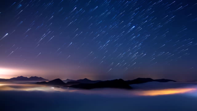 View of star trail in the sky and flowing cloud sea