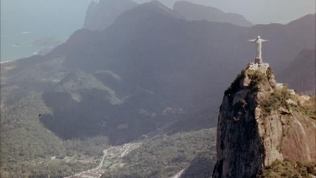WS AERIAL View of statue of christ city and Rio De Janero  / Rio De Janero , Brazil