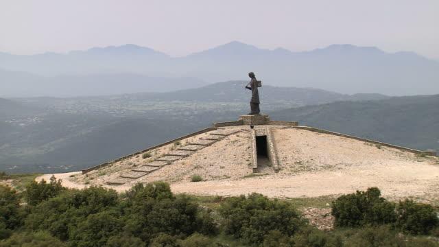 WS AERIAL View of statue on top of Mitsikeli mountain / Epiros, Thessalia, Greece