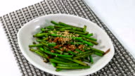 View of stir-fried garlic scape with sesame seed (Famous Korean traditional side dish)
