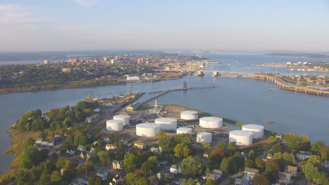 WS AERIAL POV View of storage tanks near Casco Bay Bridge and Fore River / Portland, Maine, United States