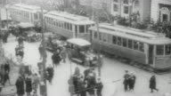 WS View of street and cars intermix with large number of pedestrians /United States