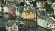 WS View of street and colorful houses next to sea / Alesund, Norway