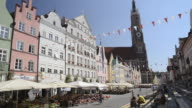 WS View of Street Cafes in decorated Old town with St. Martin basilica with tallest brick tower in the world / Landshut, Bavaria, Germany