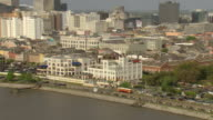 WS AERIAL View of street car driving past cabildo along Mississippi river with french quarter / New Orleans, Louisiana, United States