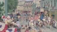 WS View of street parade in a small western town