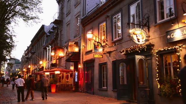 WS View of street scene of cafes on St Anne Street Rue Sainte Anne twilight in French Canada / Quebec City, Quebec, Canada