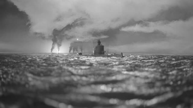 WS View of submarine in ocean with explosions in back side (miniature)