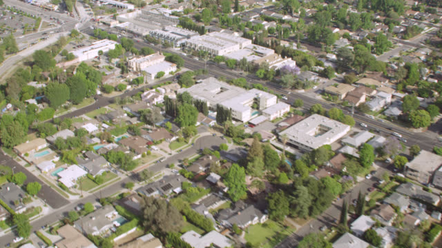 WS AERIAL View of suburban roads and housing development