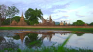 WS LD View of Sukhothai Historical Park, Mahathat temple reflecting in water