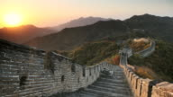 WS T/L View of Sun rising over Great Wall stone fortifications, Mutianyu / Beijing, Hebei Province, China